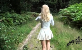 attractive-blonde-gets-fed-a-mouthful-of-cum-in-the-outdoors