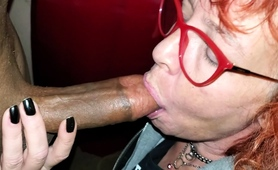 naughty-mature-redhead-takes-a-big-black-cock-in-her-mouth