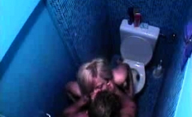Slutty blonde takes her man to the restroom to suck him off