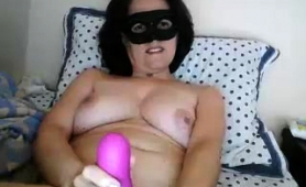 masked-brunette-milf-has-fun-with-sex-toys-on-the-webcam