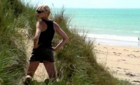 slender-blonde-milf-gives-a-wonderful-handjob-on-the-beach