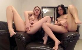 blonde-and-brunette-lesbians-masturbate-together-on-webcam