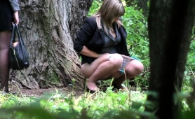 voyeur-spies-on-a-curvy-amateur-babe-pissing-in-the-woods