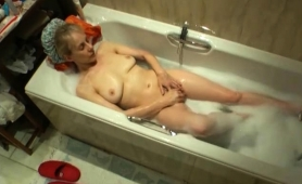Busty Mature Blonde Fingers Her Hungry Pussy In The Bathtub